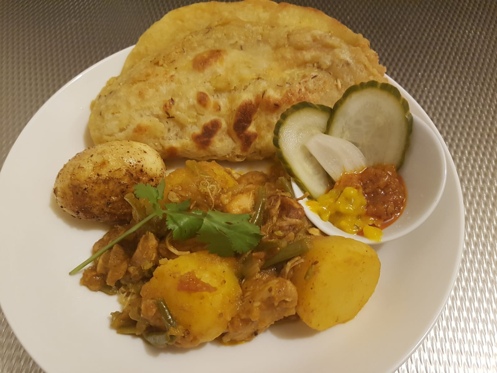 Roti met masala kip